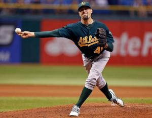 ST. PETERSBURG, FL - AUGUST 23:  Pitcher Pat Neshek #40 of the Oakland Athletics pitches against the Tampa Bay Rays during the game at Tropicana Field on August 23, 2012 in St. Petersburg, Florida.  (Photo by J. Meric/Getty Images)